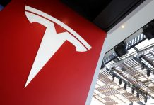 Tesla says robotaxis coming in 2020, touts self-driving microchip